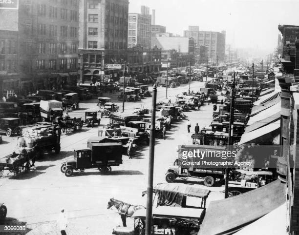 A wholesale street market in Chicago with rows of lorries