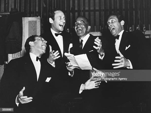 Al Jolson the Hollywood star and film actor is seen here singing with the crazy Ritz Brothers Al Jim and Harry at a charity show