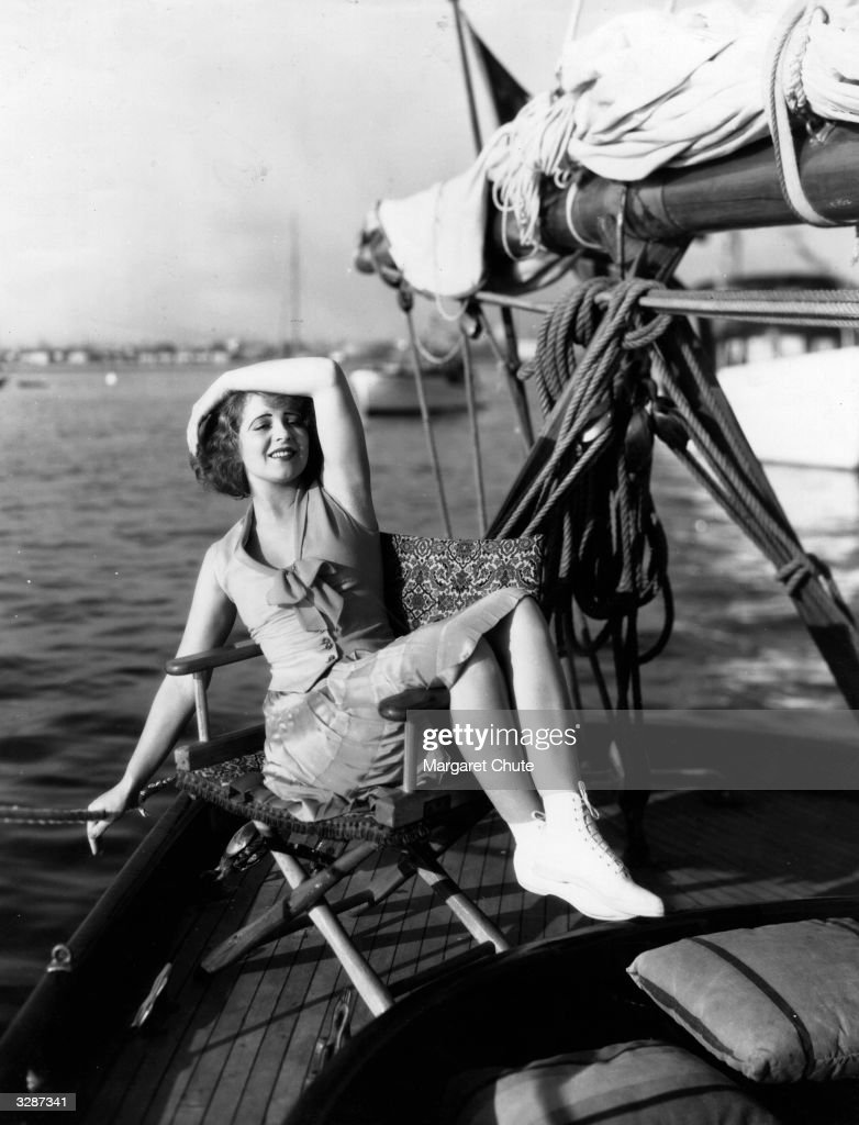 American actress Clara Bow, the 'It' girl, relaxes on board the racing schooner 'Diable', in Malibu.