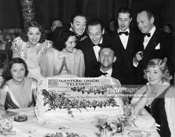 American comedian George Burns celebrating his birthday with Mrs George Levy Mary Livingston Burns' wife actress Gracie Allen Jack Pearl Jack Haley...