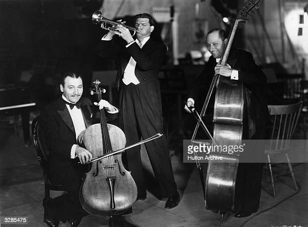 American director Alan Crosland makes music with Sigmund Romberg and Oscar Hammerstein who are responsible for the music for the Warner Brothers film...