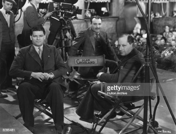 American director Alan Crosland sits with Sigmund Romberg and Oscar Hammerstein who were responsible for the music for the Warner Brothers film...