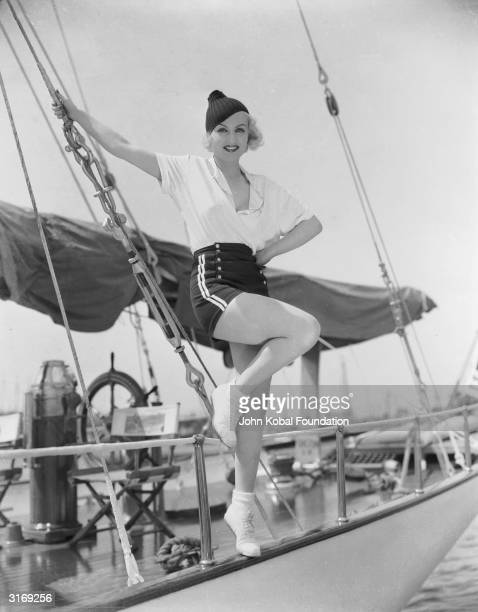 American film actress Carole Lombard wearing shorts on the deck of a yacht