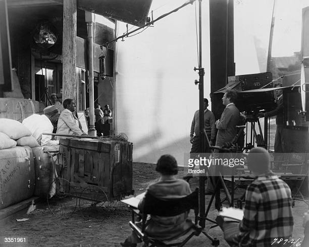 American film director Richard Wallace and his assistants on the set of 'Two Black Crows' directing the minstrel comedy duo Moran and Mack