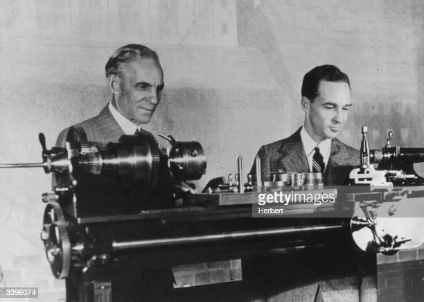 American industrialist, Henry Ford , with his son Edsel , inspecting the lathe he bought in 1894 to work out his early ideas, at the opening of the...