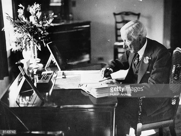 American oil magnate and philanthropist John Davidson Rockefeller at work in his study