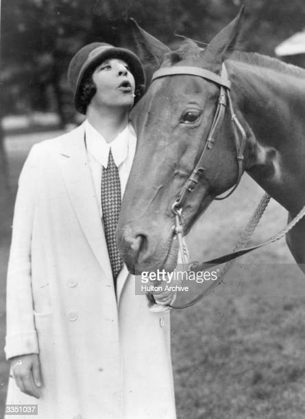 American Stage and screen entertainer Fanny Brice clowns with a horse Born Fannie Borach her life was the inspiration for the film 'Funny Girl'
