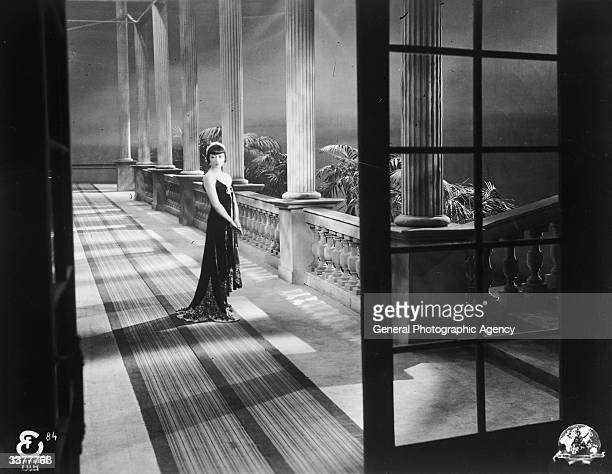AmericanChinese actress Anna May Wong beside a row of columns
