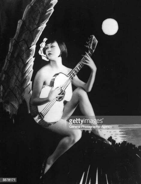 AmericanChinese actress Anna May Wong playing a guitar