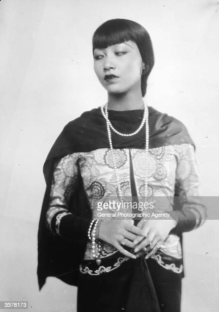 AmericanChinese actress Anna May Wong wearing a long string of beads