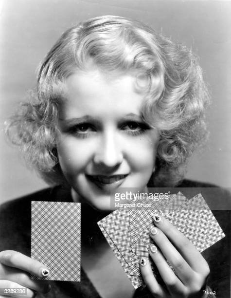 Anita Page Metro Goldwyn Mayer star is trying out the new 'bridge manicure' with the various card symbols enamelled on each finger nail She is...