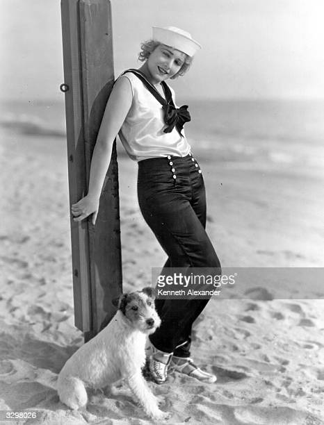 AustroHungarian actress Vilma Banky and her dog outside her Malibu beach house