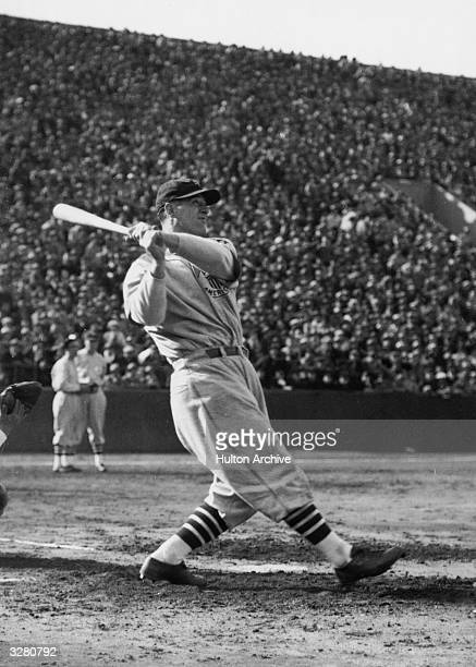 Baseball star Lou Gehrig at the moment of his home-run hit at his game between Major League and All Japan.
