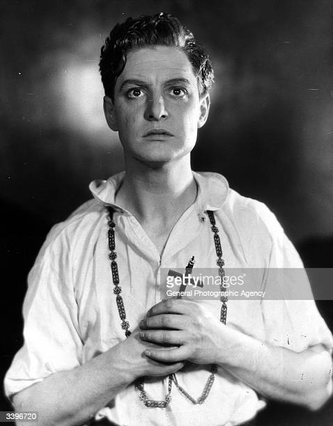 British actor Robert Donat clutching crucifix in his role as Martin in The Witch at the Embassy Theatre London The play was translated from the...