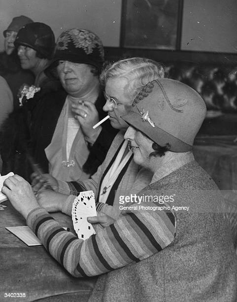 Card players playing bridge bridge was introduce to the United Kingdom in the late 19th century