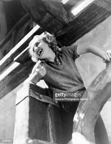 Carole Lombard originally Jane Alice Peters American actress leaning on timbers