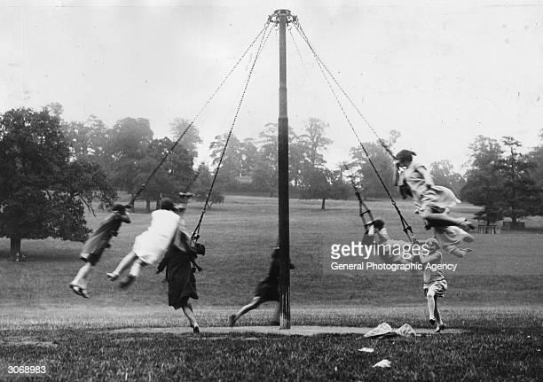 Children playing on a maypole in Richmond Park