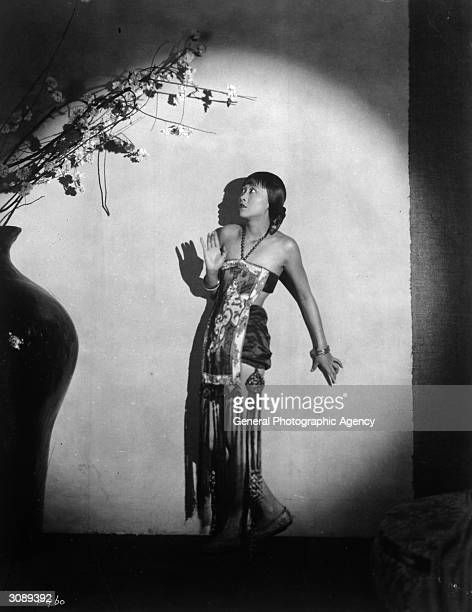 ChineseAmerican actress Anna May Wong surrounded by ominous shadows