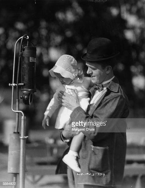 Comic film actor Stan Laurel with his daughter Lois