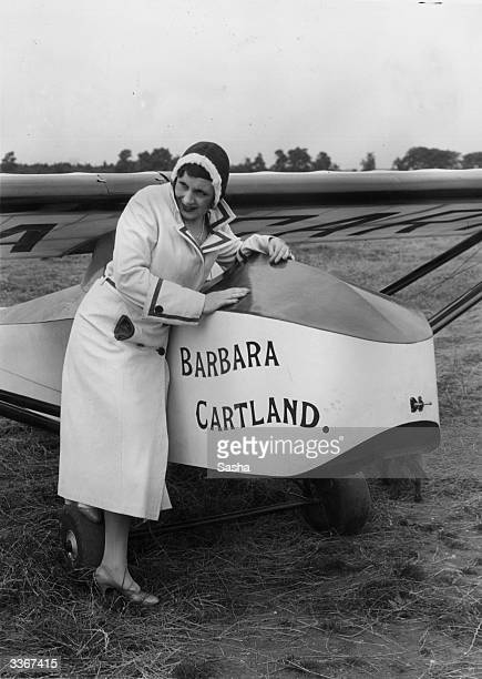 English novelist Barbara Cartland with the glider 'Barbara Cartland' in which she accomplished the first long distance tow in Britain. The tow was...