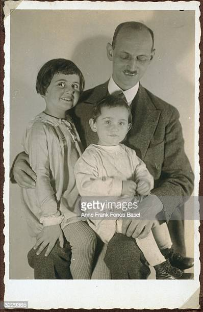 EXCLUSIVE A family portrait of Otto Frank and his daughters Margot and Anne Frank sitting on his lap Frankfurt am Main Germany From Margot Frank's...