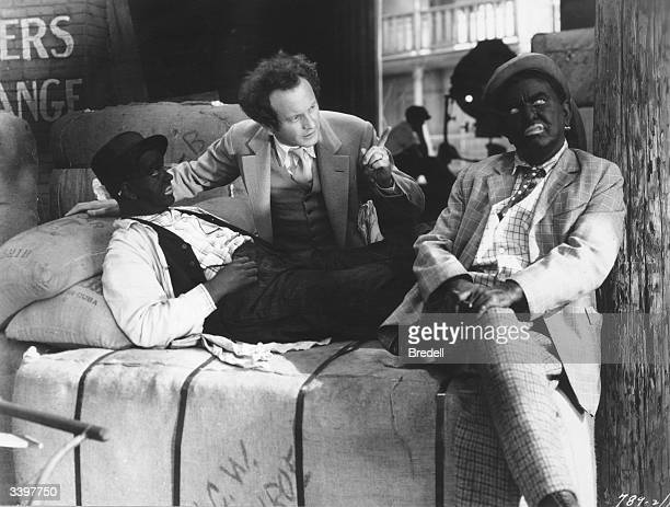 Film director Richard Wallace directing Charles Mack and George Moran of the vaudeville comedy minstrel team 'Moran and Mack' in the film 'Two Black...