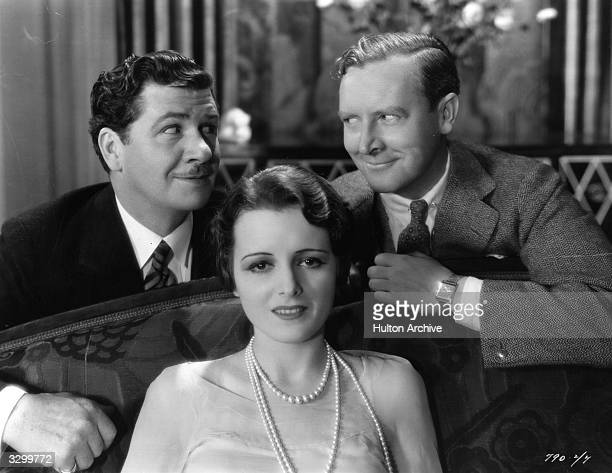 George Bancroft and director Rowland Lee are plotting something but Mary Astor sitting in front of them is unaware of their intentions A relaxing...