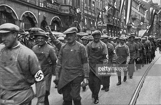 German workmen marching in a Nazi parade