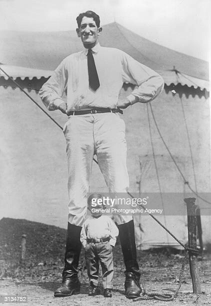 Jack Earle the 8ft 6in 'Texas Giant' poses with a midget Born Jacob Ehrlich Earle travelled with the circus for fourteen years before retiring after...