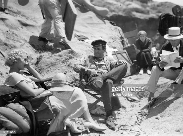 Leila Hyams and John Gilbert on the set of the MGM film 'Way For A Sailor' with director Sam Wood The movie tells of the adventures of a tough...