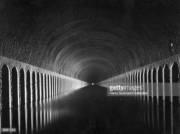 Light shines on the canal at the end of the Tunnel de Roue, near Marseilles.