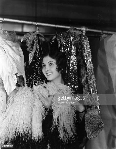 Marion Shilling the Hollywood star and Paramount player is not certain which of these gorgeous gowns from the wardrobe department she should pick to...