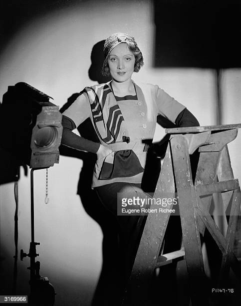 Marlene Dietrich behind the scenes with hands on hips.