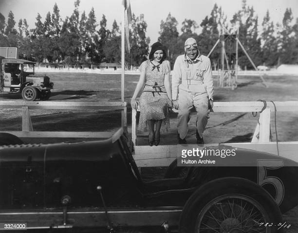 Mary Brian and Richard Arlen take a break from filming the speedway romance 'Burning Up' directed by A Edward Sutherland for Paramount