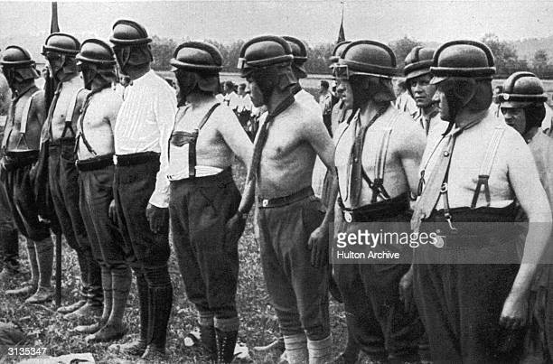 Members of the SA the paramilitary wing of the Nazi Party stripped of their brown shirts