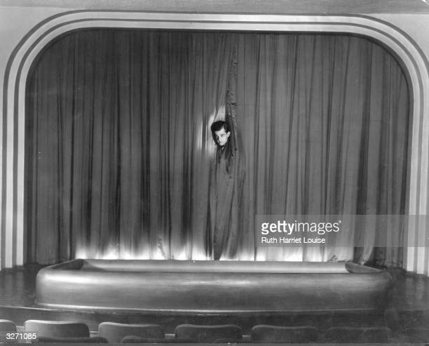 Metro Goldwyn Mayer actor Ramon Novarro on the stage of his private theatre at his Hollywood home.
