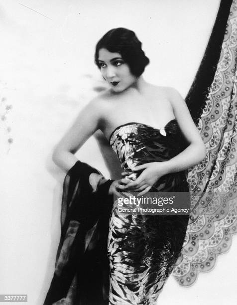 Mexican-born Hollywood film actress Dolores Del Rio wearing an evening dress.