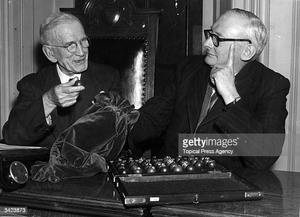 Officials drawing the balls from a velvet bag to determine who plays who in the FA cup