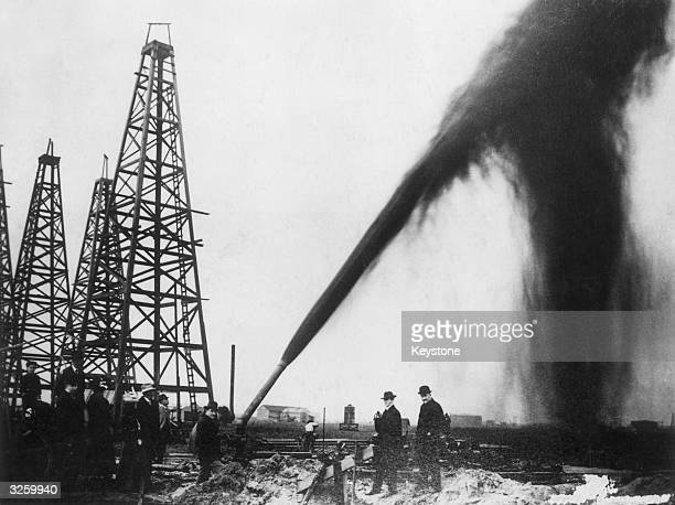 Oil gushing out of a pipe on an oilfield in the USA