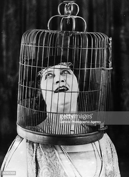 Opera singer at the New York Met Marie Tiffany singing 'like a bird' with her head in a bird cage