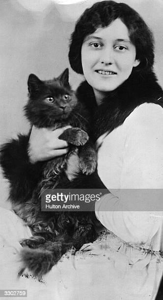 Princess Elizabeth Bibesco wife of Prince Antoine Bibesco holding a cat