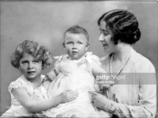 Queen Elizabeth, Queen Consort to King George VI with Princesses Elizabeth and Margaret Rose .