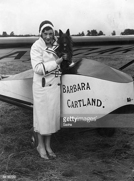 Romance novelist Barbara Cartland poses beside the glider in which she made the first long distance towed journey in England, from Hanworth to...