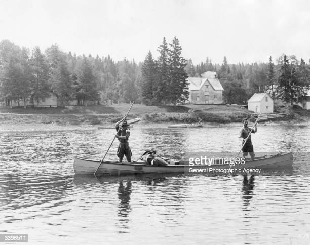 Salmon fishers heading up the Restigouche River from Kedgwick New Brunswick Canada