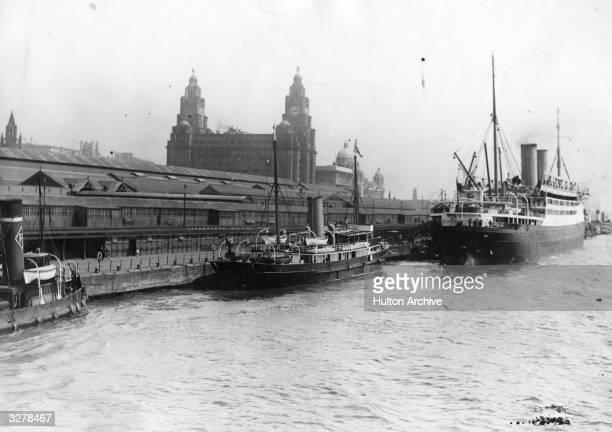 Scene of the dockside in Liverpool with vessels alongside