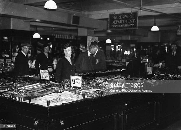 Shoppers in the hardware department of a Woolworth's store