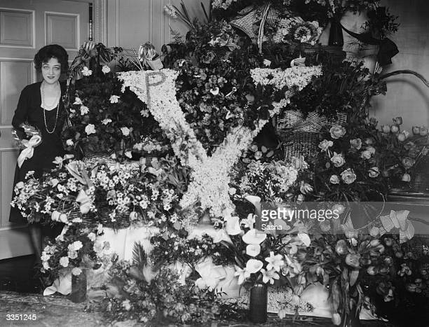 Silent film star Pauline Frederick of Madame X fame with floral tributes including one in the shape of an X