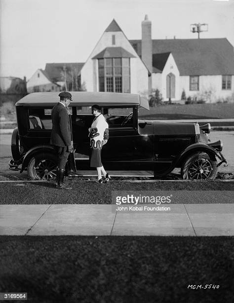 The chauffeur opens the car door for French screen actress Renee Adoree the stage name of Jeanne de la Fonte Prior to her Hollywood career she was a...