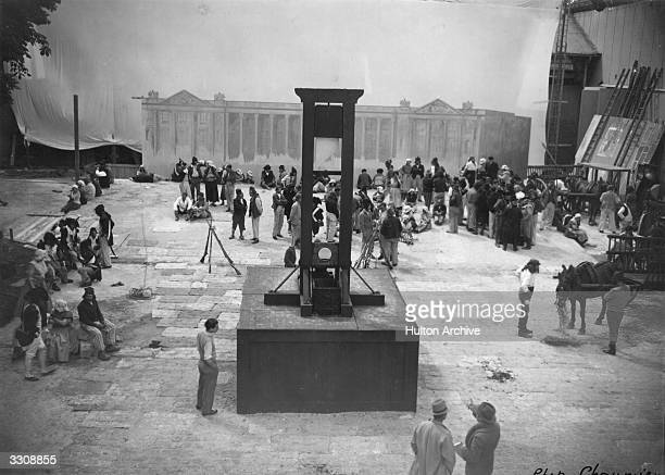 The guillotine being positioned on the set of the French film 'Danton'