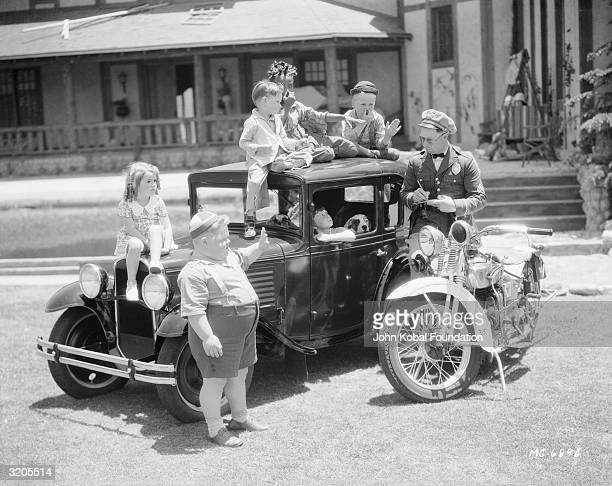 The kids from Our Gang are stopped by a policeman for underage driving